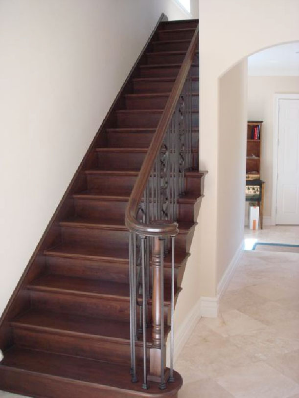 Custom Cherry Stairway with Decorative Iron Railing